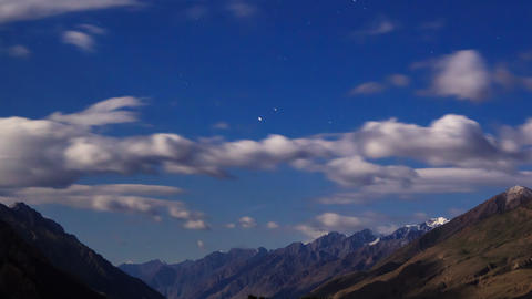 Moonlit night in the mountains. Time Lapse Stock Video Footage