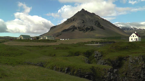 village at bottom of volcano in iceland Footage