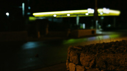 Gas station at night defocused cars passing by Footage