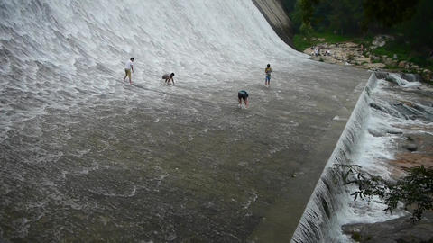 Torrential waterfall & spindrift,boy playing water... Stock Video Footage