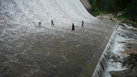 Torrential waterfall & spindrift,boy playing water under dam Animation
