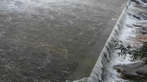 Torrential waterfall & spindrift running to dam Stock Video Footage