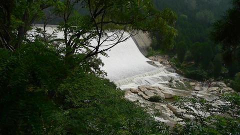 Torrential waterfall & spray from dam,Mountain Tai-shan Stock Video Footage
