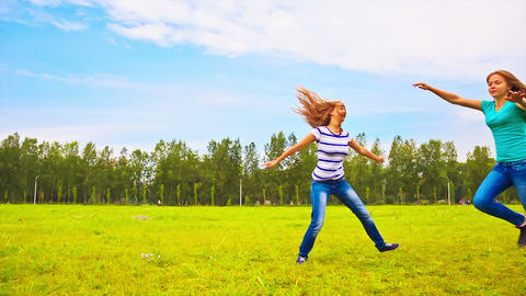 Teens running through the meadow Footage