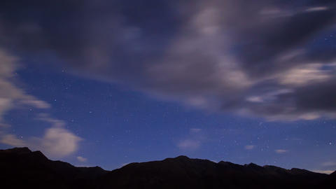 Night in the mountains. Time Lapse. 4K Stock Video Footage