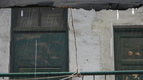 falling rain & dilapidated house Stock Video Footage