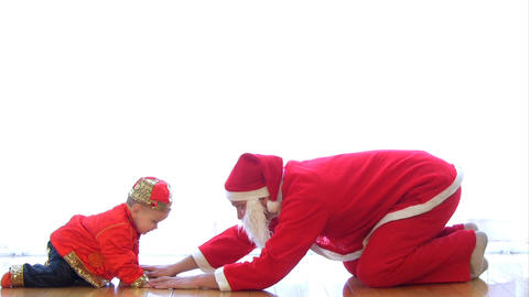 Santa Claus playing with baby Stock Video Footage