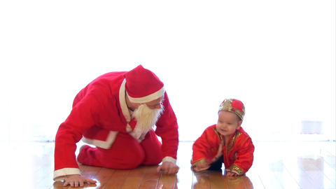 Santa Claus playing with kid Footage