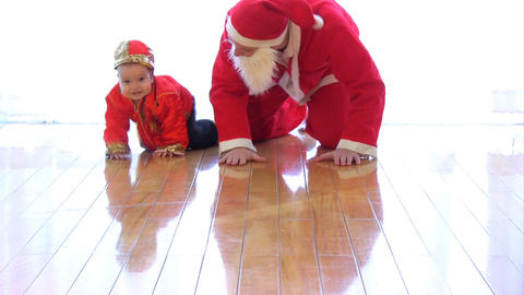 Santa Claus playing with kid Stock Video Footage