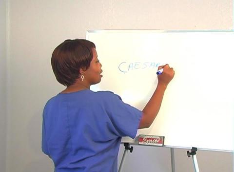 "Beautiful Nurse Writes ""Caesarean Section"" on a White Board Stock Video Footage"