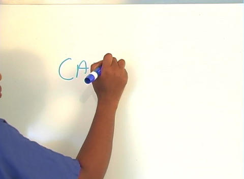 "Beautiful Nurse Writes ""Cataracts"" on a White Board... Stock Video Footage"