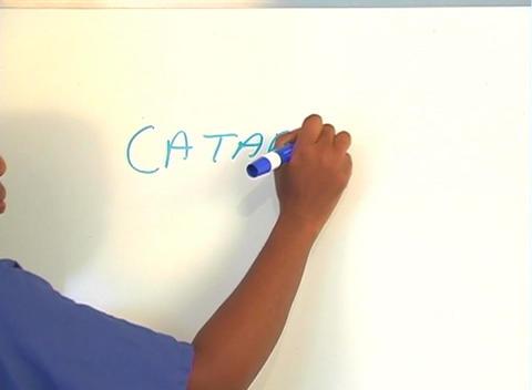 "Beautiful Nurse Writes ""Cataracts"" on a White Board... Stock Video Footage"