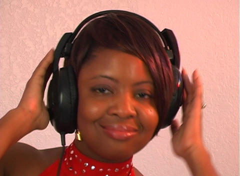 Beautiful Woman Listens to Music with Headphones (4) Stock Video Footage