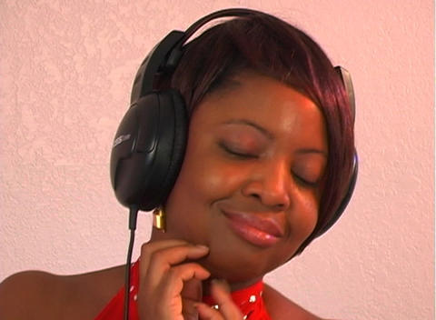 Beautiful Woman Listens to Music with Headphones (4) Footage