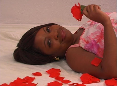 Beautiful Woman Lying Amidst Rose Petals (2) Footage
