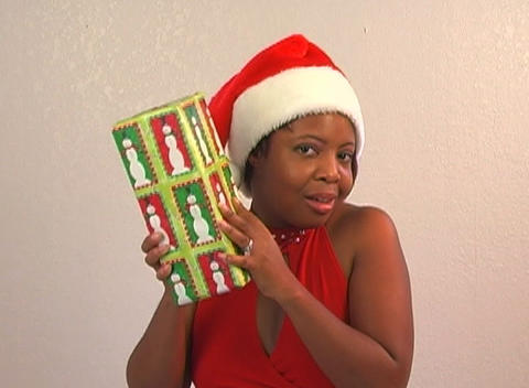 Beautiful Woman Shakes a Christmas Gift (2) Stock Video Footage
