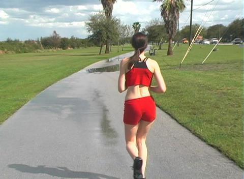 Beautiful Woman Jogging Away (1) Stock Video Footage