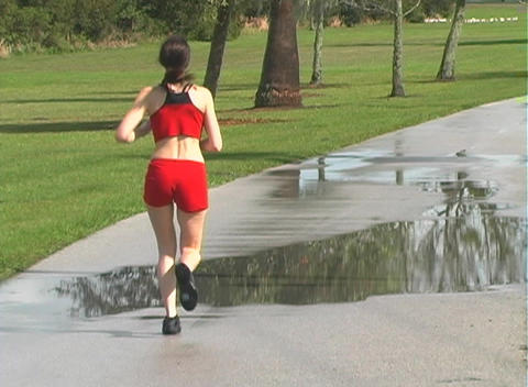 Beautiful Woman Jogging Away (1) Footage