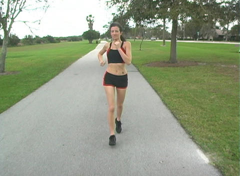 Beautiful Woman Jogging (4) Stock Video Footage