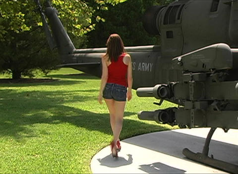 Sexy Woman at Military Helicopter Stock Video Footage