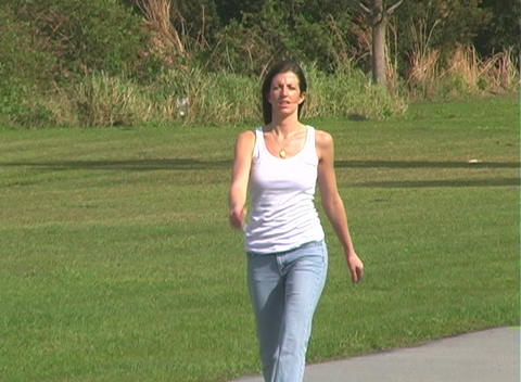 Beautiful Brunette Walking Outdoors Stock Video Footage