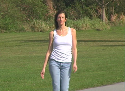 Beautiful Brunette Walking Outdoors Footage