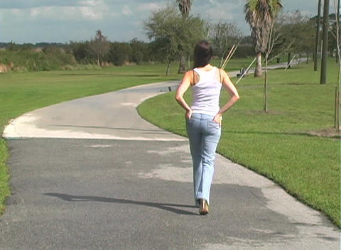 Beautiful Brunette Walking Away Outdoors Stock Video Footage