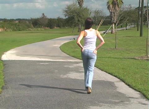 Beautiful Brunette Walking Away Outdoors Stock Video Footage