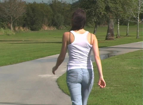 Beautiful Brunette Walking Away Outdoors Footage