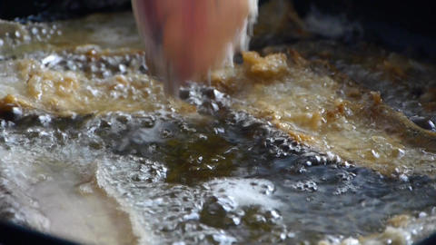 Fried fish with boiling Stock Video Footage