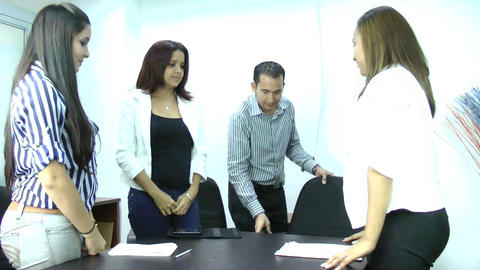 Manager giving a friendly reception to his busines Stock Video Footage