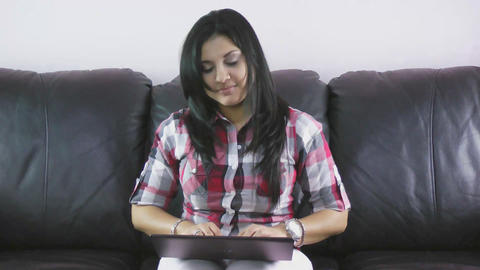 Attractive young woman dancing using her laptop Footage
