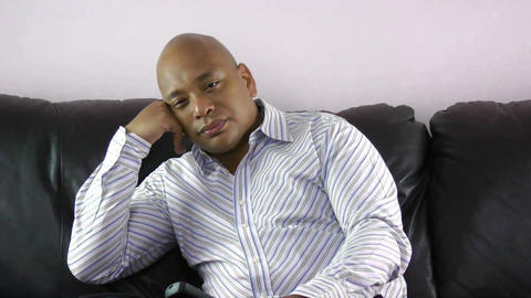 Bored African Businessman Watching Tv stock footage