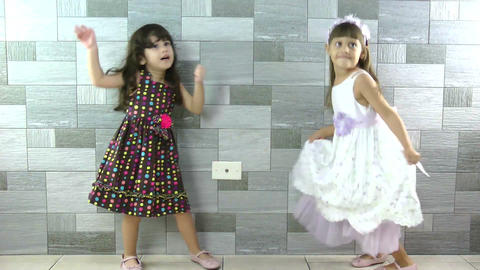 Happy little girls dancing Footage