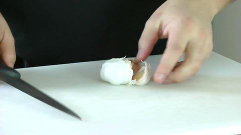 Garlic being peeled Stock Video Footage