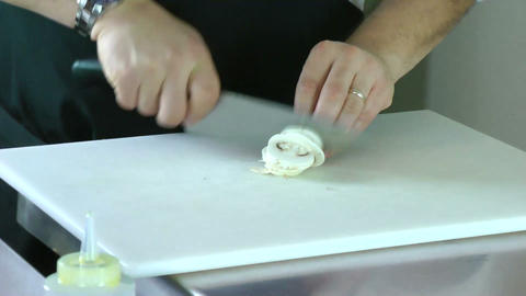 Cropped view of the hands of a man slicing a mushr Stock Video Footage