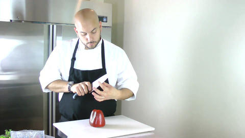 Chef Testing The Knife In The Kitchen. Timelapse stock footage