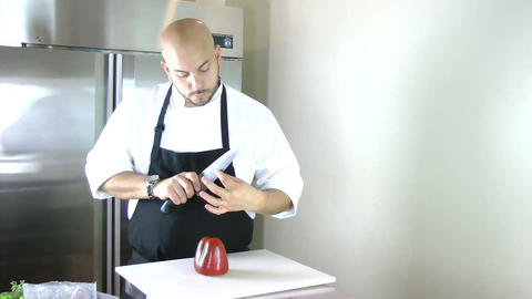 Chef testing the knife in the kitchen. Timelapse Stock Video Footage