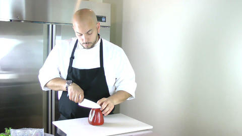 chef cutting peppers for salad Stock Video Footage