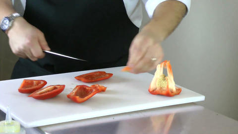 chef cutting peppers for salad Footage