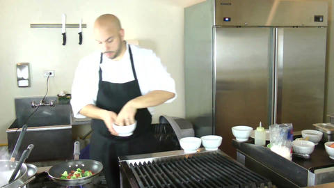 Chef cooking vegetables in pan Stock Video Footage