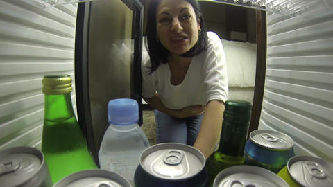 woman looks in the fridge very hungry and doesn't Stock Video Footage