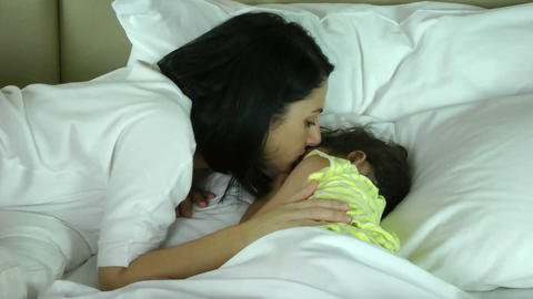 Mother wakes up her daughter in the bedroom Stock Video Footage