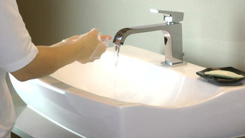 Washing of hands with soap under running water Stock Video Footage