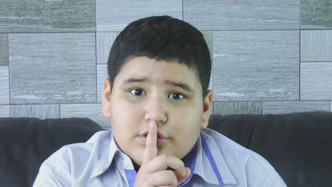 little boy with silence gesture Stock Video Footage