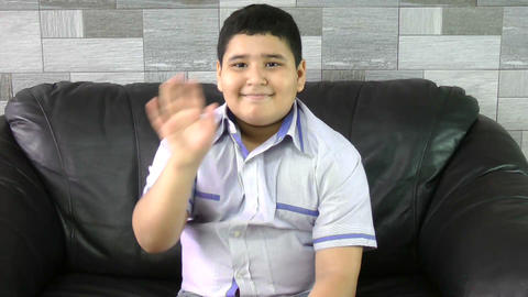 Young boy waving goodbye Stock Video Footage