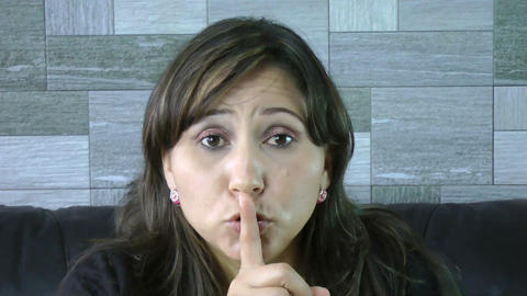 closeup of woman making a hush gesture Stock Video Footage