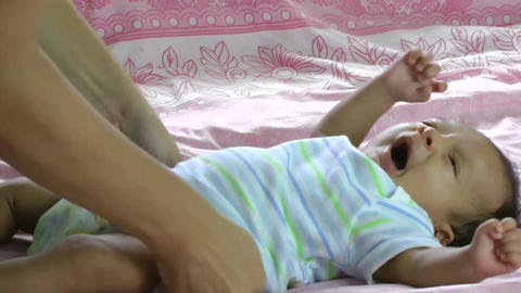 newborn hispanic baby yawns Footage
