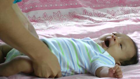 newborn hispanic baby yawns Stock Video Footage