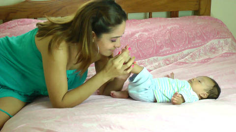 happy young hispanic mother kissing her two months Stock Video Footage